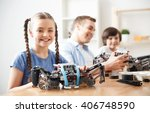 positive kids playing with lego  | Shutterstock . vector #406748590