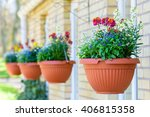 Row Of Hanging Flowerpots With...