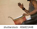 African Man Playing Drum With...