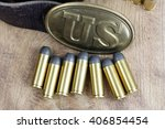 Small photo of American Civil War concept - US Army Belt Buckle with revolver cartridges
