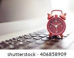 alarm clock on laptop concept... | Shutterstock . vector #406858909