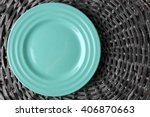 Empty Plate On Wicker Mat...