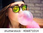 beautiful young woman blowing a ... | Shutterstock . vector #406871014