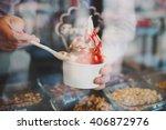 seller pours sauce on a soft... | Shutterstock . vector #406872976