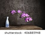 Vase Of White Flower With...