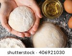 Female Hands Holding Dough  To...