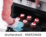 woman baking cupcakes in the... | Shutterstock . vector #406924606