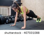 Small photo of fit woman doing push-ups on the floor, sporty female working out abs, arm muscles