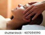 beautiful woman having an head... | Shutterstock . vector #407054590
