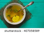 clear soup with vegetables in...