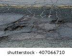 Cracked Asphalt Road Surface...
