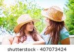 portrait of joyful young mother ... | Shutterstock . vector #407073424