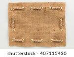 frame of burlap  lies on a... | Shutterstock . vector #407115430