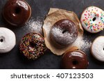 Colorful Donuts On Stone Table. ...