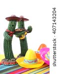 Small photo of Cinco de Mayo Mariachi Band cactus with sombero hats on festive table with white background, and copy space.