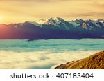fantastic range in mist at the... | Shutterstock . vector #407183404