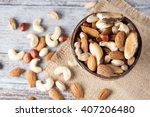 healthy mix nuts on wooden... | Shutterstock . vector #407206480