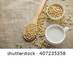 soybeans and soy milk on sack... | Shutterstock . vector #407235358