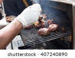 chef making beef burgers... | Shutterstock . vector #407240890