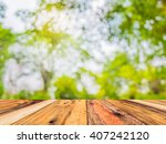 wood table and blur image of... | Shutterstock . vector #407242120