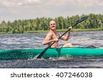 a man goes into a kayak | Shutterstock . vector #407246038