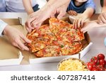 Happy Family Eating Pizza On...