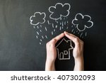 hands protects a house from the ... | Shutterstock . vector #407302093