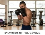 young muscular sports guy in... | Shutterstock . vector #407339023