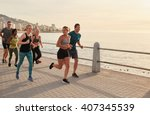 young runners workout along a... | Shutterstock . vector #407345539