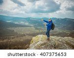 woman on top of mountain.... | Shutterstock . vector #407375653