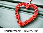 Red Heart Wreath At A Door