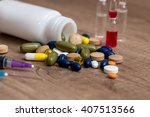 Pills And Syringe On Desk