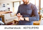 man working from home using... | Shutterstock . vector #407519590