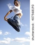 young man jumping | Shutterstock . vector #407568193