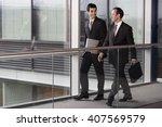 two businessmen walking along... | Shutterstock . vector #407569579