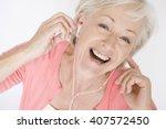 a senior woman listening to... | Shutterstock . vector #407572450