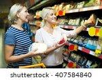 adult blonde helping female... | Shutterstock . vector #407584840