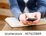 female hands holding a mobile... | Shutterstock . vector #407625889