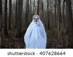 Evil Clown In A Mask Standing...