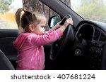 little girl sitting behind the... | Shutterstock . vector #407681224