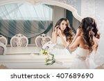 beautiful bride in a wedding... | Shutterstock . vector #407689690