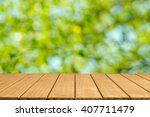 empty top wooden table and...   Shutterstock . vector #407711479