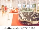 blur photo of visitors at motor ... | Shutterstock . vector #407713108