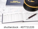 Small photo of Close up of an airplane pilot equipment including flight log,hat,weather map and preflight document