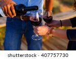 spilled red wine by the glass  | Shutterstock . vector #407757730