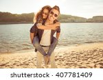 happy young man piggybacking... | Shutterstock . vector #407781409