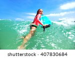 kid girl is learning surfing ... | Shutterstock . vector #407830684