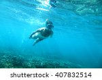 Woman Is Snorkeling Underwater