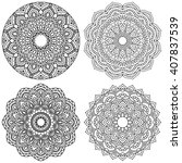 set of ethnic round ornaments.... | Shutterstock .eps vector #407837539