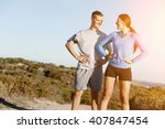 young couple on beach training... | Shutterstock . vector #407847454